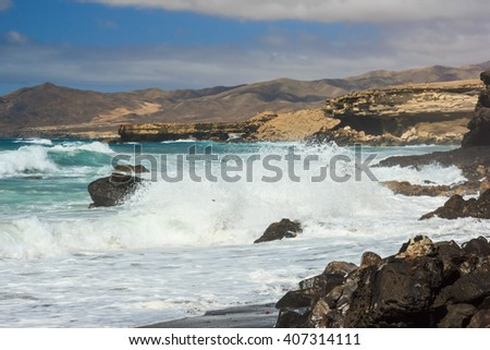 Huge waves crashing on the rocks , Fuerteventura island, Spain. - stock photo