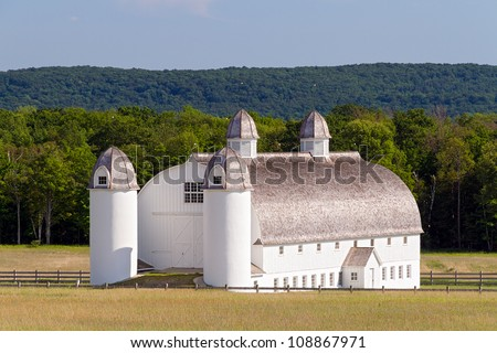 Huge white 19th Century barn with silos on the historic DH Day Farm in Michigan's Sleeping Bear Dunes National Lakeshore - stock photo