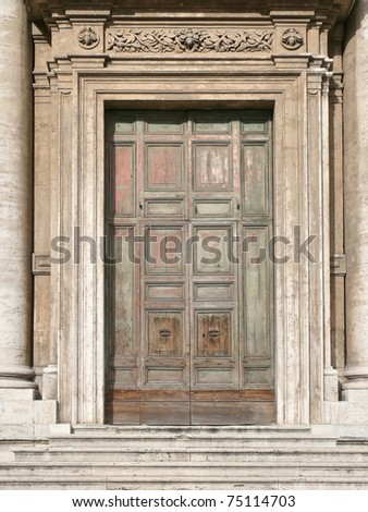 Huge wooden door. More of this motif & more wooden doors in my port. - stock photo