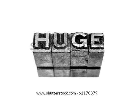 HUGE written in metallic letters on a white background - stock photo