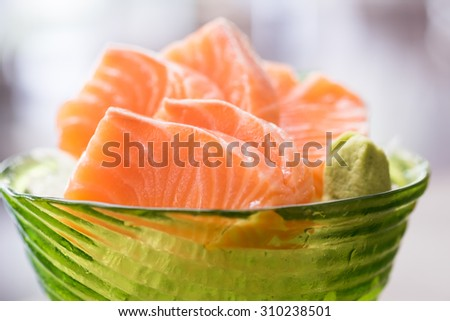 Huge Yummy Salmon Sushi in the green bowl with wasabi (Selective Focus Point) - stock photo