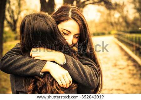 Hugging best friend  - stock photo