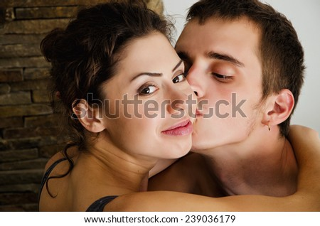 Hugging couple. Close-up portrait - stock photo