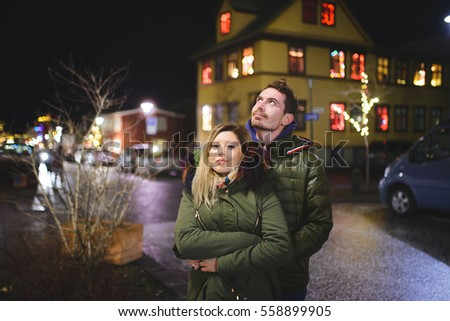 hugging couple in night street at house