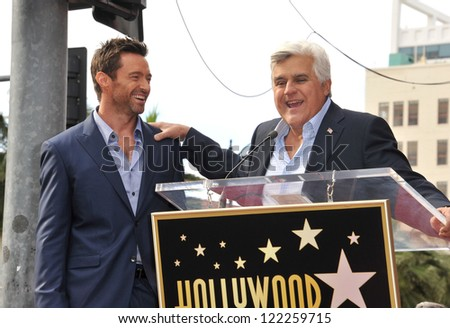 Hugh Jackman & Jay Leno (right) on Hollywood Blvd where Jackman was honored with the 2,487th star on the Hollywood Walk of Fame. December 13, 2012  Los Angeles, CA Picture: Paul Smith - stock photo