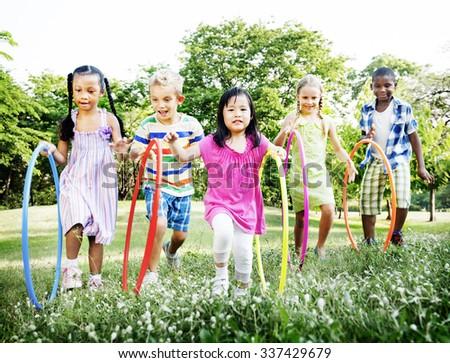 Hula Hooping Park Children Cheerful Concept - stock photo