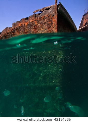 Hulks of Shipwrecks viewed from waterline by scuba diver - stock photo