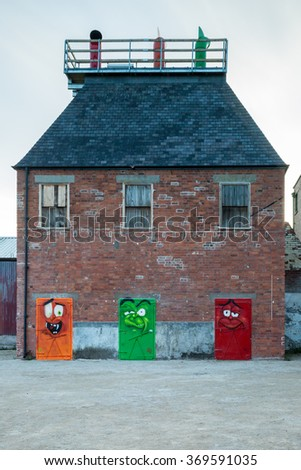 HULL, ENGLAND - SEPTEMBER 26: The Old Smokehouse colourful metal doors in Hull Old Town on September 26 2014 in Hull, England. - stock photo