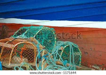 Hull of boat and Lobster Pots - stock photo