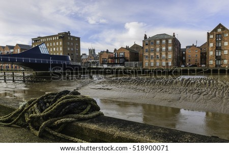 Hull, Yorkshire, UK. View across the river Hull in autumn with view of Scale Lane Bridge swing bridge and houses, offices and Holy Trinity Church in Hull, Yorkshire, UK.