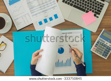 human are working to analyze the data for the company to plan. above view. - stock photo
