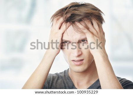 Human at home suffering from headaches - stock photo