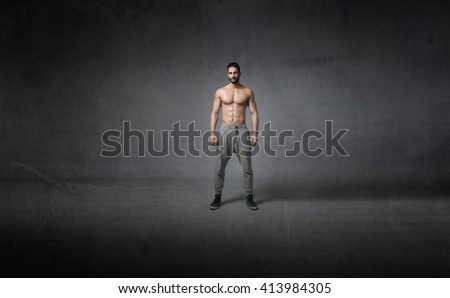 human body ready for workout, dark background - stock photo