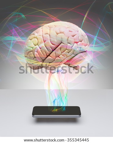 Human brain and smart phone  - stock photo