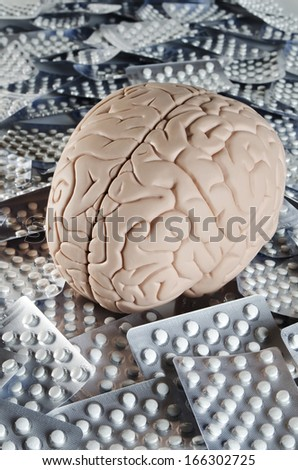 Human brain model with pills  - stock photo