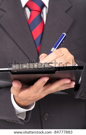 Human business man hand pen writing paper document - stock photo