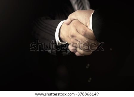 Human Business Man Handshake Partner Black Background Trust Respect Investment Day Insurance Agent CSR Boss Work Unity Agree Firm Deal Job Sale Strong Union Office Team Final Suit World Formal Concept - stock photo