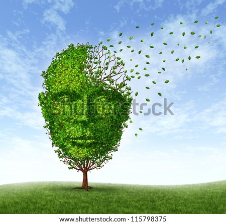 Human dementia problems as memory loss due to age and Alzheimer's disease with the medical icon of a tree in the shape of a front face human head and brain losing leaves as  mind function fades away. - stock photo