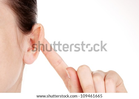 Human ear and hand close-up isolated on white - stock photo