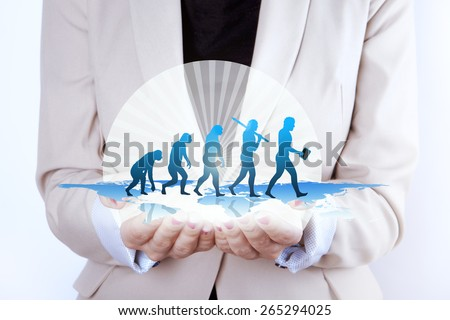Human evolution / Growth in businesswoman hands - stock photo