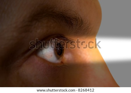 Human eye and light beam - stock photo