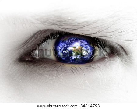 human eye with an integrated planet earth in it - stock photo