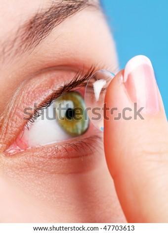 human eye with corrective lens on a blue - stock photo