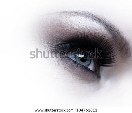 Human eye with eyelashes over white background - stock photo