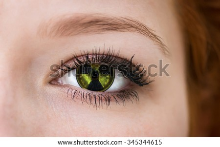 Human eye with radiation hazard symbol - concept photo. - stock photo