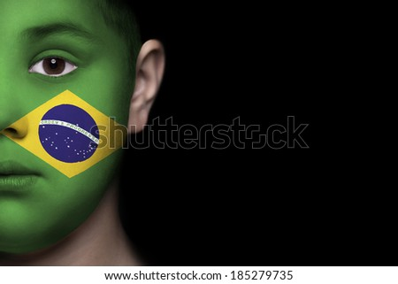 Human face painted with flag of Brasil - stock photo