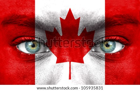 Human face painted with flag of Canada