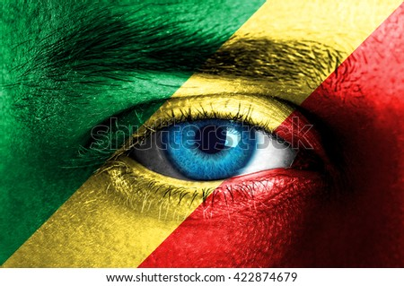 Human face painted with flag of Congo
