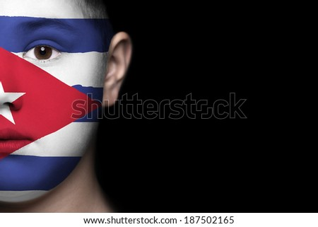 Human face painted with flag of Cuba - stock photo