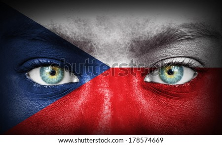 Human face painted with flag of Czech Republic - stock photo