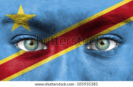 Human face painted with flag of Democratic Republic of Congo - stock photo