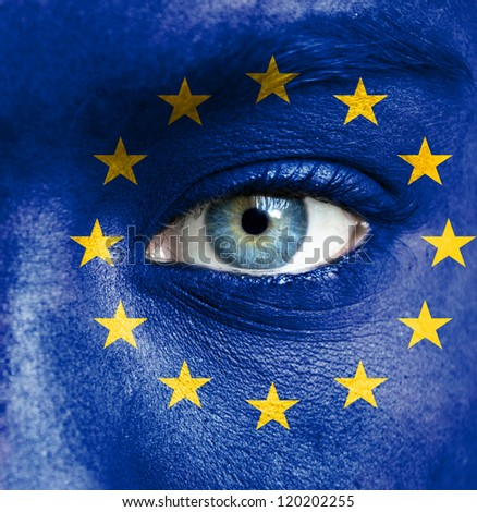 Human face painted with flag of European Union - stock photo