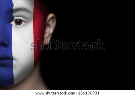 Human face painted with flag of France - stock photo