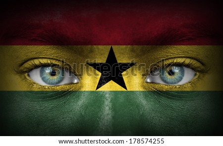 Human face painted with flag of Ghana - stock photo