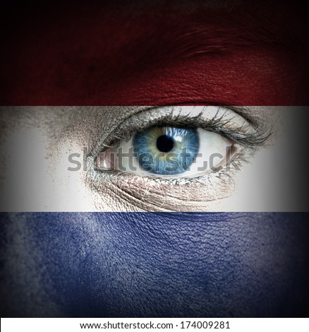 Human face painted with flag of Netherlands - stock photo