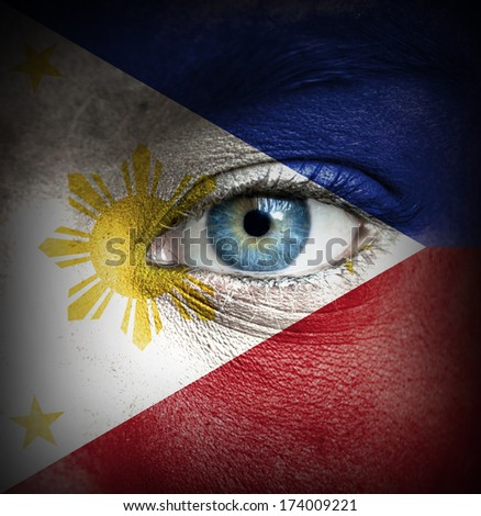 Human face painted with flag of Philippines