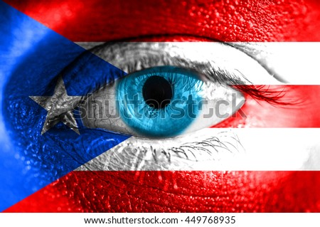 Human face painted with flag of Puerto Rico