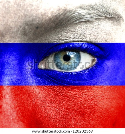 Human face painted with flag of Russia - stock photo