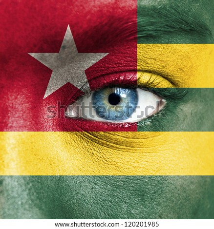 Human face painted with flag of Togo