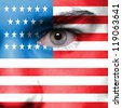 Human face painted with flag of USA - stock photo