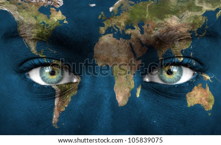 "Human face painted with planet earth - ""Elements of this image furnished by NASA"" - stock photo"
