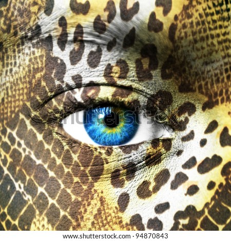 Human face with animal patterns - Save endangered species concept - stock photo