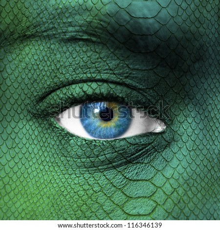 Human face with dragon skin texture - stock photo