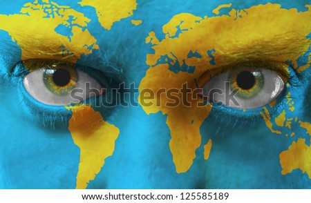 Human face with painted map of world - stock photo