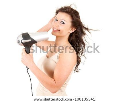 human fashion - beautiful girl drying her hair by dryer, white background