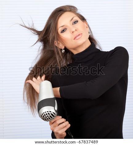 human fashion - beautiful woman drying her hair by dryer - stock photo